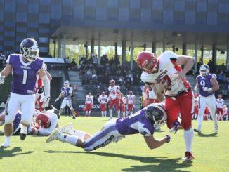 Denmark rallies to win first-round playoff game