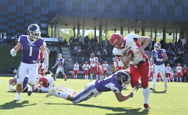 Denmark rallies to win first-round playoff game